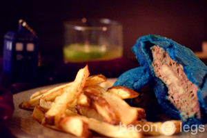 TARDIS-blue pastry wrapped around a bacon-covered burger
